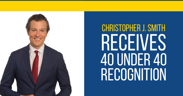 "Left: a picture of Christopher Smith in a suit. Right: in gold and white lettering, ""CHRISTOPHER J. SMITH RECEIVES 40 UNDER 40 RECOGNITION."""